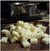 Cubed block of muenster cheese